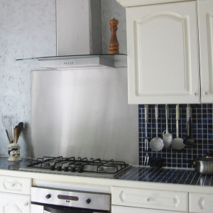 Brushed stainless steel cooker hood splashback